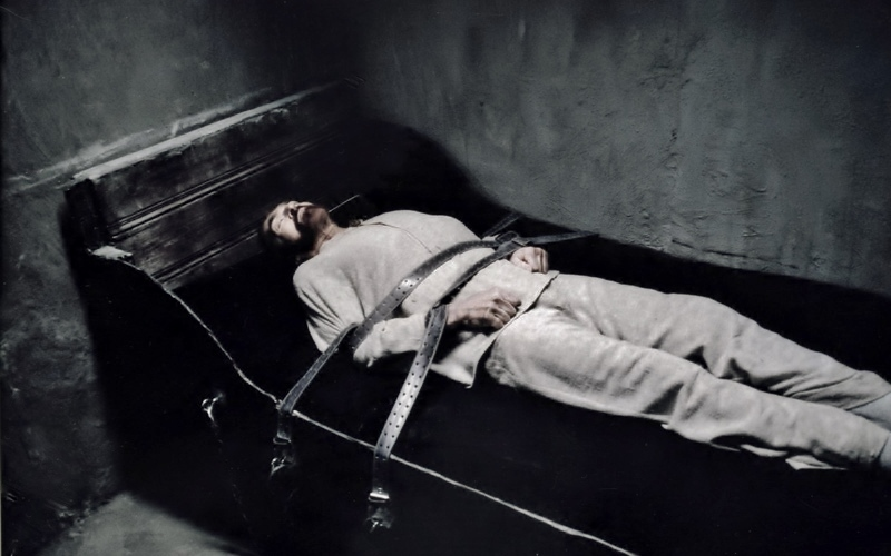 Film still - Van Gogh (Alexander Barnett) restrained at asylum The Eyes of Van Gogh