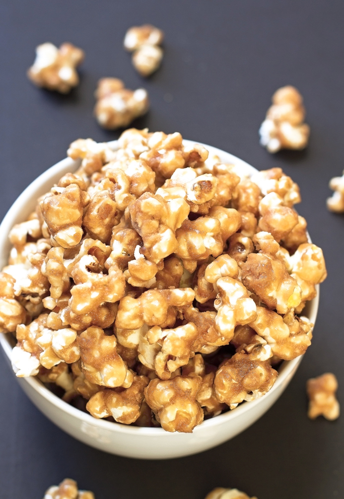 Homemade Caramel Corn - buttery and loaded with caramel this is the perfect movie night treat + it's perfect for gift giving! #popcorn #caramelcorn #gourmet #dessert | littlespicejar.com