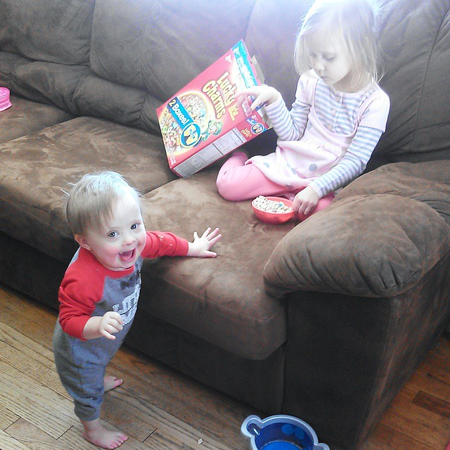 Trying to keep Liam away from Lily's snack. Story of my life. Not that I blame him. Lucky Charms!!!! #momlife