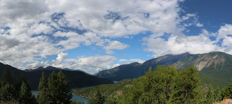 Panorama view over Ross Lake from Highway 20, with Jack Mountain in the clouds, right