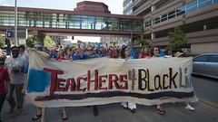 Teachers union members march for justice for Philando Castile