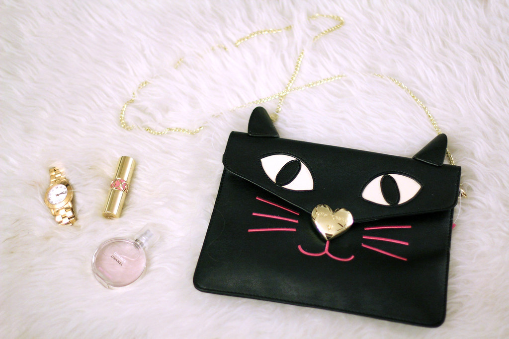Betsey Johnson Cat Purse, YSL Volupte Lipstick, Chanel Eau Tendre, Marc by Marc Jacobs Amy watch, Zappos holiday guide