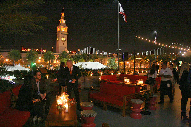 The outdoor patio boasts a view facing the Ferry Building and Bay Bridge