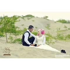 a simple prewedding photo. simple view. very nice couple. @meilysuhendra and @herrysst prewedding photoshoot in Gumuk Pasir Parangkusumo Yogyakarta.   prewedding photo by @Poetrafoto.  visit our web http://prewedding.poetrafoto.com and our FB page http://