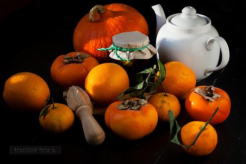 Persimmons, tangerines, oranges and pumpkin