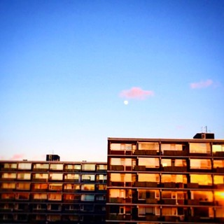 Beautiful moon from office window. #beautiful #moon #blue #sky #sunset #moonrise #office #window #view #evening #iphone