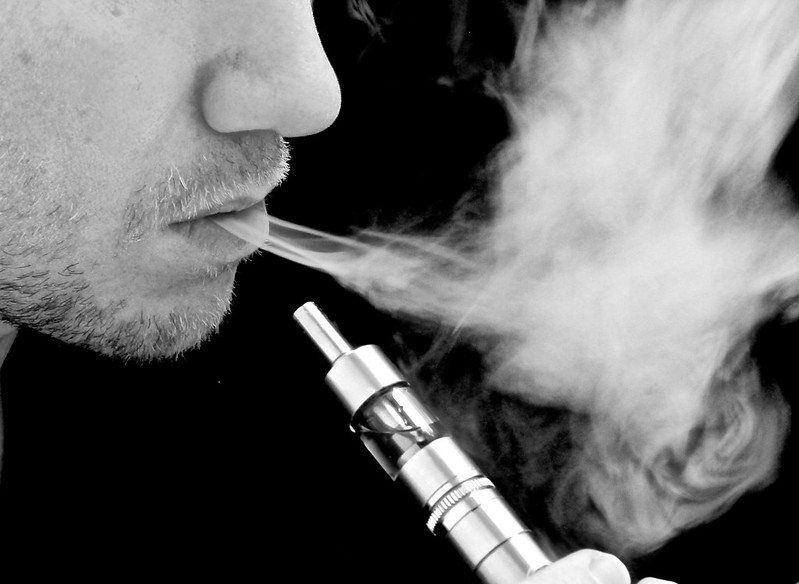 Man using an electronic cigarette / Vaping E Cig