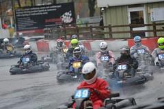motorcycle(0.0), pit stop(0.0), motorcycling(0.0), auto racing(1.0), go-kart(1.0), kart racing(1.0), racing(1.0), sport venue(1.0), vehicle(1.0), sports(1.0), race(1.0), motorsport(1.0), race track(1.0),