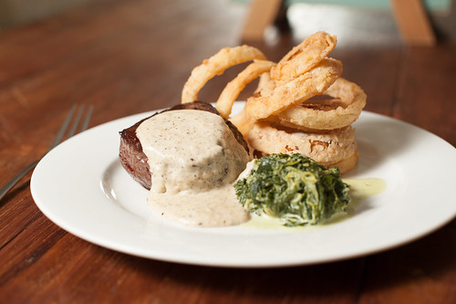 Sous vide fillet steak with onion rings and pepper sauce