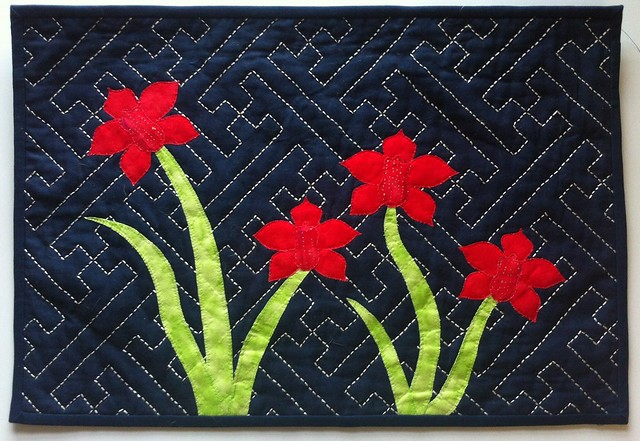 Sashiko and orchids wall hanging quilt, sayagata background quilting.