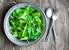 Green salad on rustic background