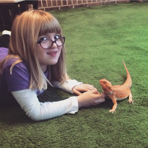 A girl and her dragon.