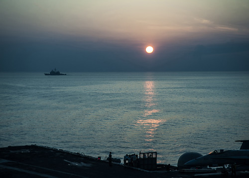 ARABIAN GULF - The guided-missile cruiser USS Bunker Hill (CG 52) transits the Arabian Gulf at sunset.