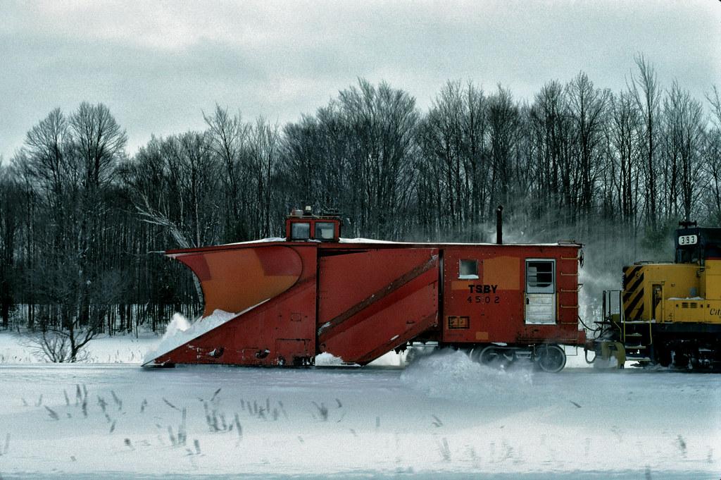 T&SBY plow train along US131 south of Kalkaska on 1-24-94.