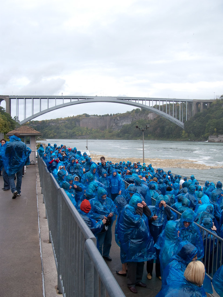 People wearing blue ponchos waiting in line for the Maid of the Mist