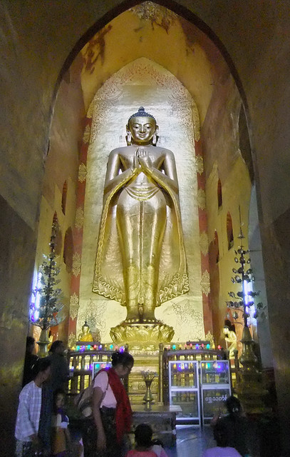Buddha Towering Above Worshippers in Ananda Pagoda in Bagan, Myanmar