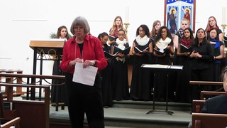 Kathy Hutchins opening meeting; presentation of Vox Unum from Stuart County Day School of the Sacred Heart, Erin Camburn, director. WCC_Dec2014GenMtg