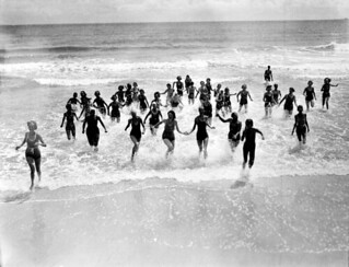 Campers running on beach at the FERA camp for unemployed women - Anastasia Island
