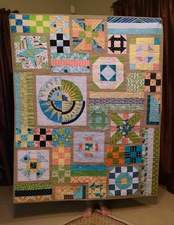 It's finally quilted. And I love it. These blocks look fantastic together. Thank you Grace circle ladies.