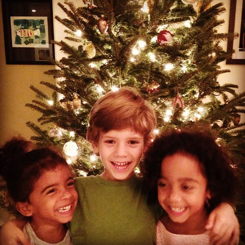 Cousins in front of the tree...