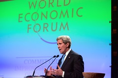 U.S. Secretary of State John Kerry speaks about sustainability efforts to an audience that included former U.S. Vice President Al Gore, former British Prime Minister Gordon Brown, and United Nations Secretary-General Ban Ki-moon on January 23, 2015, during the World Economic Forum in Davos, Switzerland. [State Department Photo/Public Domain]