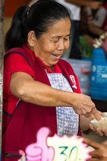 Image of Chatuchak Market near Charoen Pokphand Foods (CPF) Plc. Co. Ltd.. thailand bangkok thumbsup streetvendor chatuchak krungthepmahanakhon chatuchakweekendmarket streetstalls coconuticecream jjmarket