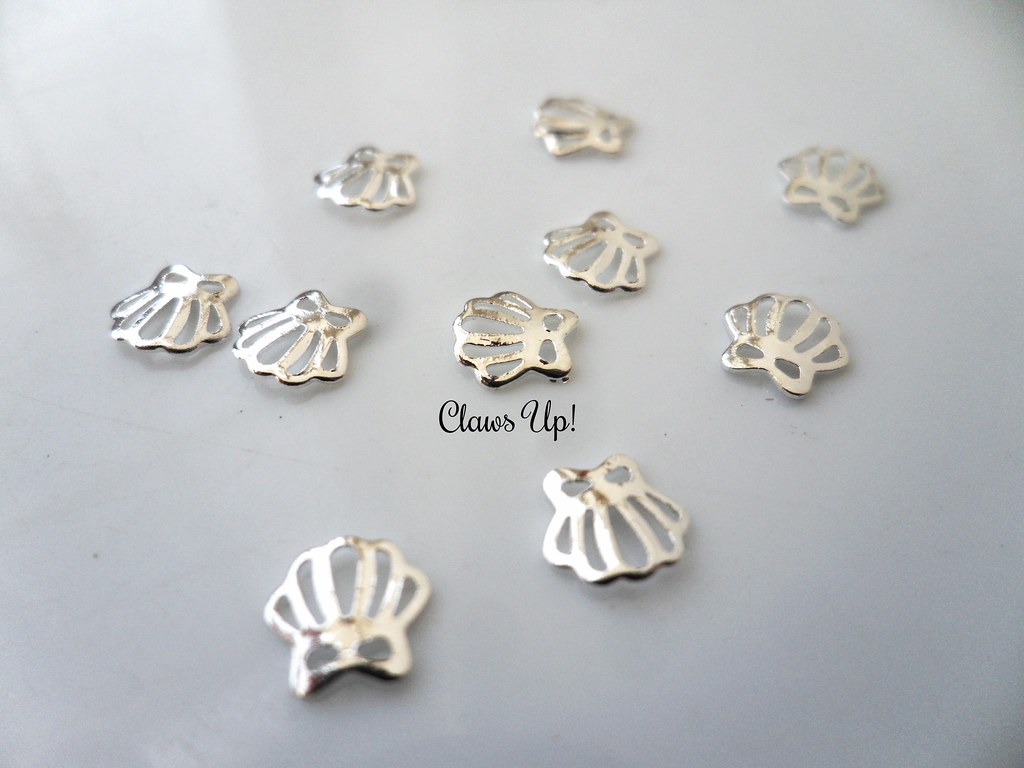 Born Pretty Store silver seashell nail studs Coupon code JACG10