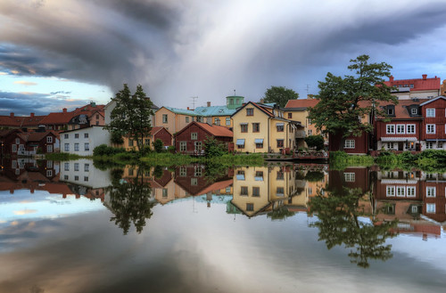 city trees houses sunset sky lake grass clouds reflections landscape cloudy sweden gamlastan sverige oldtown hdr eskilstuna waterscape eskilstunaån