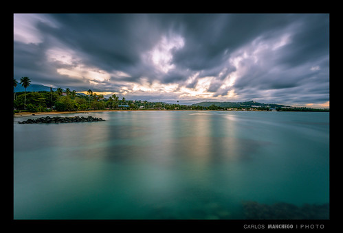 sunset sea green clouds rocks aqua puertorico luquillo yunque bedrocks