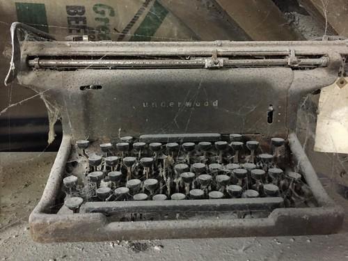 Dusty cobwebbed old underwood typewriter