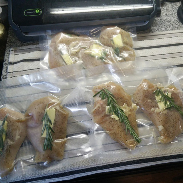 Sealing up some chicken for the week. #sousvide #healthy #cooking Seal with fresh rosemary and other aromatics. Really elevates the end product. March 04, 2015 at 11:31AM