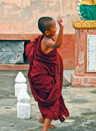 A Child Monk Playing at the Monastery near the Entrance to Inle Lake, Myanmar