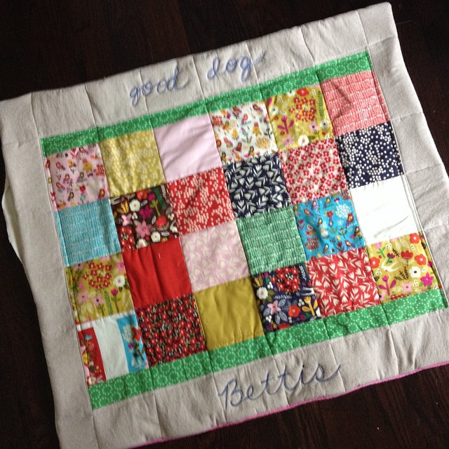 Doggy quilt/nap mat finished except closing that opening.  Whew, quilting through 4 layers of batting is a workout!  Thank you again, Christina!  Love that charm pack @free2bquilting