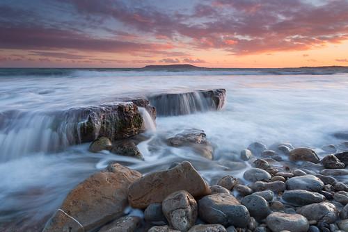 sunset england cloud photography coast movement rocks waves jake unitedkingdom ledge dorset pike jurassic osmingtonmills