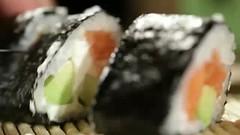 Cutting sushi rolls.