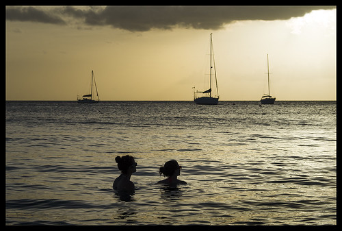 ocean girls light sunset sea summer mer sol silhouette sailboat swimming boats island golden soleil mar warm champagne coucher calm tropical barbados caribbean relaxed tropics caribe barbade