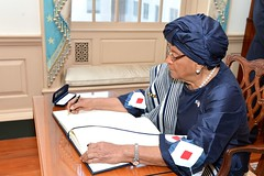 Liberian President Ellen Johnson Sirleaf signs U.S. Secretary of State John Kerry's guest book before their meeting at the U.S. Department of State in Washington, D.C., on February 27, 2015. [State Department photo/ Public Domain]