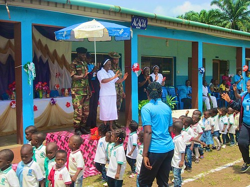 Cecilian Lengpang SSL waves at the children at the St Louis Nursery and Primary School, Akure, 16th biennial Interhouse Sports Competition