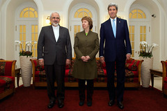 U.S. Secretary of State John Kerry, Baroness Catherine Ashton of the European Union, and Foreign Minister Javad Zarif of Iran stand before photographers in Vienna, Austria, on November 20, 2014, before sitting down for a three-way discussion about the future of Iran's nuclear program. [State Department photo/ Public Domain]