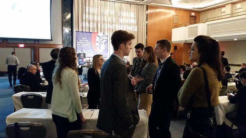 At the Global Trade Symposium, UConn students talk with students from Newcastle University in the UK.