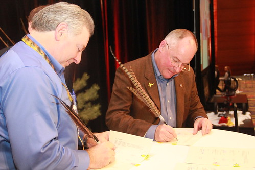 Howard Vincent, Pheasant Forever and Quail Forever's President and Chief Executive Officer (left) and FSA Administrator Val Dolcini sign an agreement establishing a framework of cooperation between Pheasants Forever and USDA agencies, including Farm Service Agency and Natural Resources Conservation Service, to maintain and enhance the productivity of pheasant, quail, and other wildlife habitats on private and public lands.