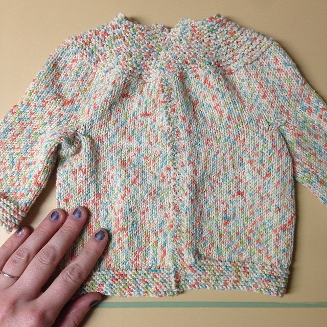 Just finished this tiny little sweater that totally looks like a funfetti cupcake to me. But I have no idea what size baby it's supposed to fit, and I gots to figure out some kind of closure type things. Hand for size reference.