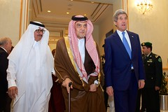 U.S. Secretary of State John Kerry walks with Foreign Minister Saud al-Faisal of Saudi Arabia on March 5, 2015, in Riyadh, Saudi Arabia, before the two attend a meeting of the regional Gulf Cooperation Council. [State Department photo/ Public Domain]