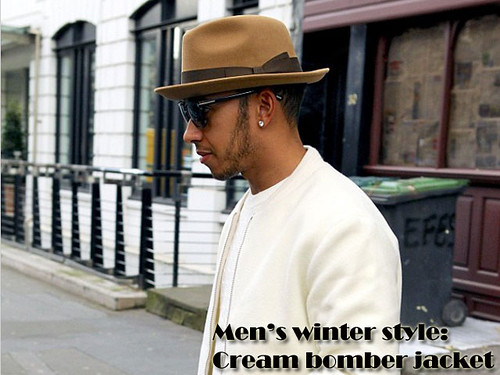 Lewis Hamilton in Men's blue biker racer jeans, cream bomber jacket, camel fedora hat, cream knit & dark shades: Men's winter style