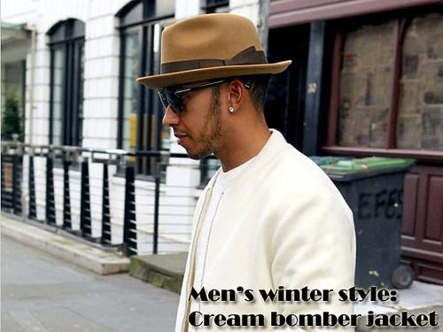 Lewis Hamilton in Men's blue biker racer jeans, cream bomber jacket, camel fedora hat, cream knit & dark shades: Men's winter style