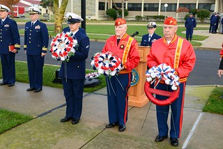 Members of the Marine Corp Dramis Detachment and a Coast Guard recruit prepare to place wreaths during a Veterans Day ceremony aboard the U.S. Coast Guard Training Center Cape May, N.J., Nov. 11, 2014. The ceremony is one of several ceremonies that members of the training center attended throughout Cape May County this Veterans Day. (U.S. Coast Guard photo by Chief Warrant Officer John Edwards)