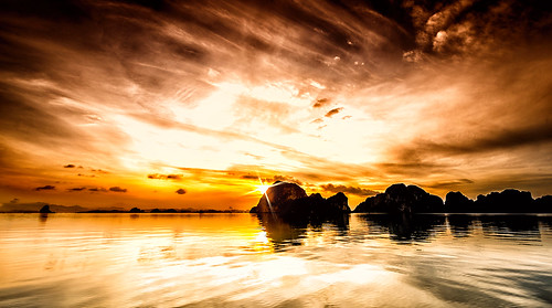 morning sky reflection heritage nature colors clouds sunrise landscape bay rocks asia unesco vietnam sunrays halong southchinasea lightrays