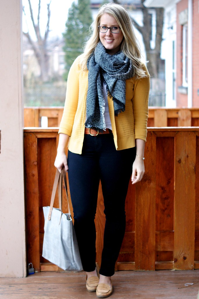 mustard cardigan with black and brown accessories