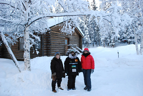 From left, Bureau of Land Management employee Marnie Graham, musher Heidi Sutter, and U.S. Forest Service employee Carol Teitzel meet to discuss learning opportunities for local youth to get involved in dog sled racing. (U.S. Forest Service)