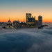Pittsburgh glows above the fog before sunrise by Dave DiCello
